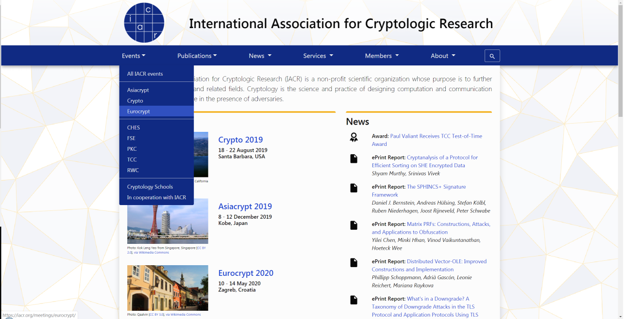 Screenshot of the main IACR website. There is a dark blue menu that is open. The background is pale gray triangles with faint orange outlines.